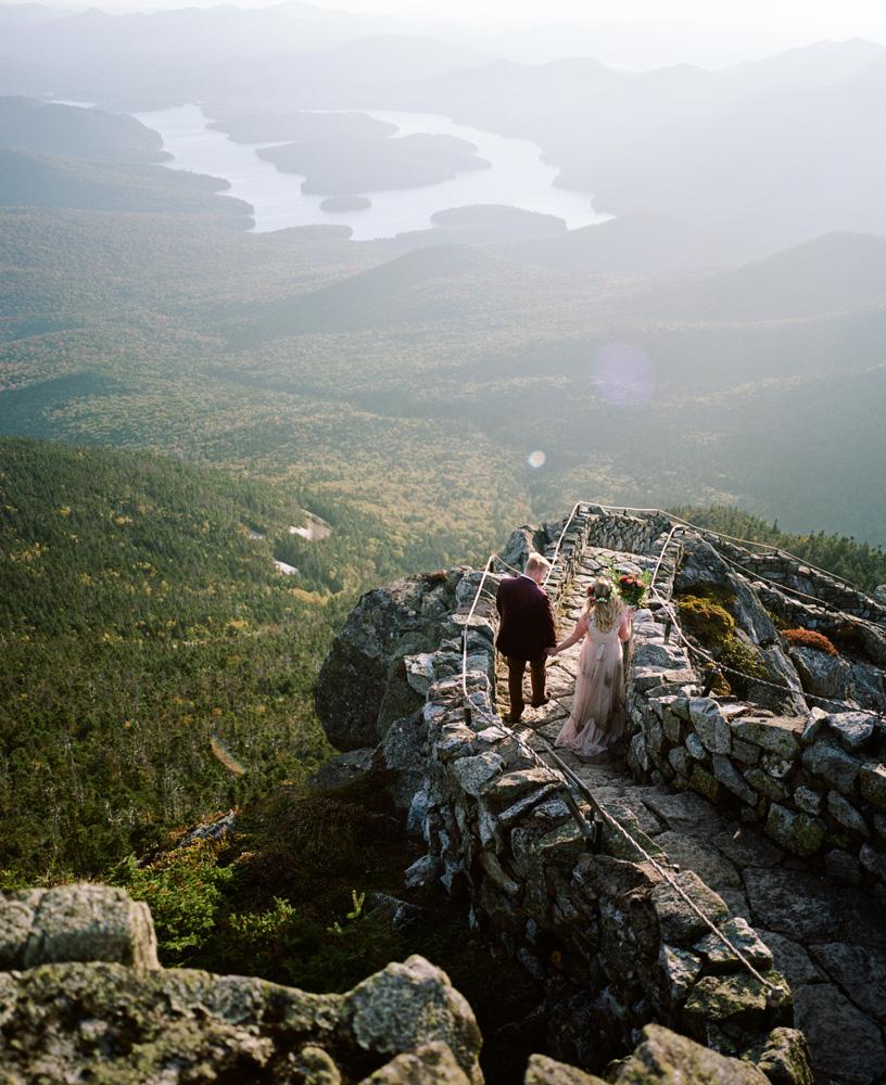 Bride and groom outside on stone ski walkway