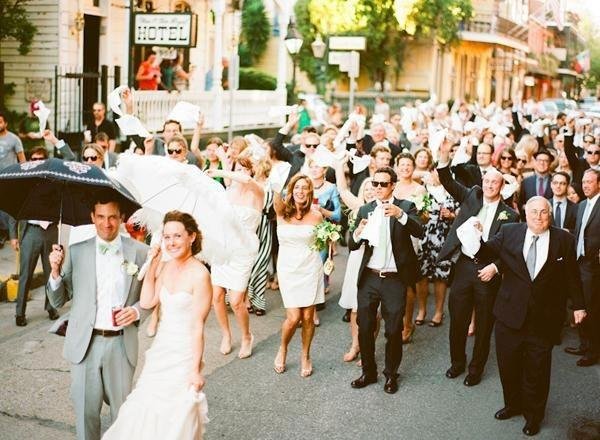bride, groom, wedding party, friends and family parading through New Orleans