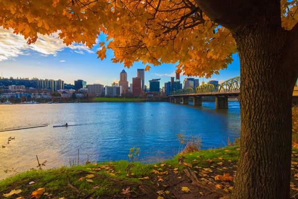 Fall lake view of Portland city skyline