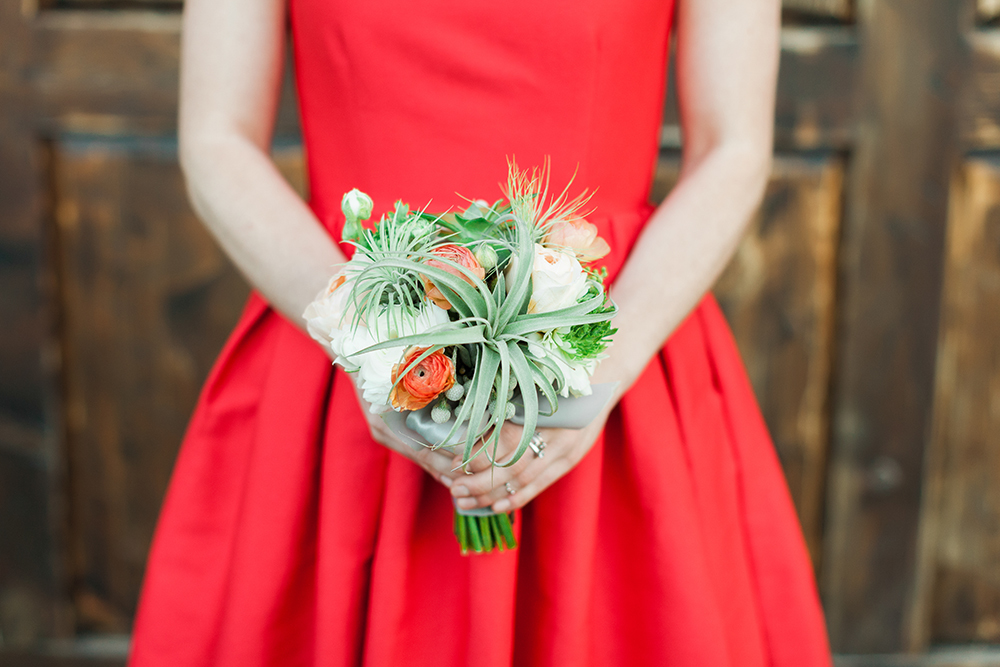 Planning a wedding - bright bridesmaid dress and bouquet