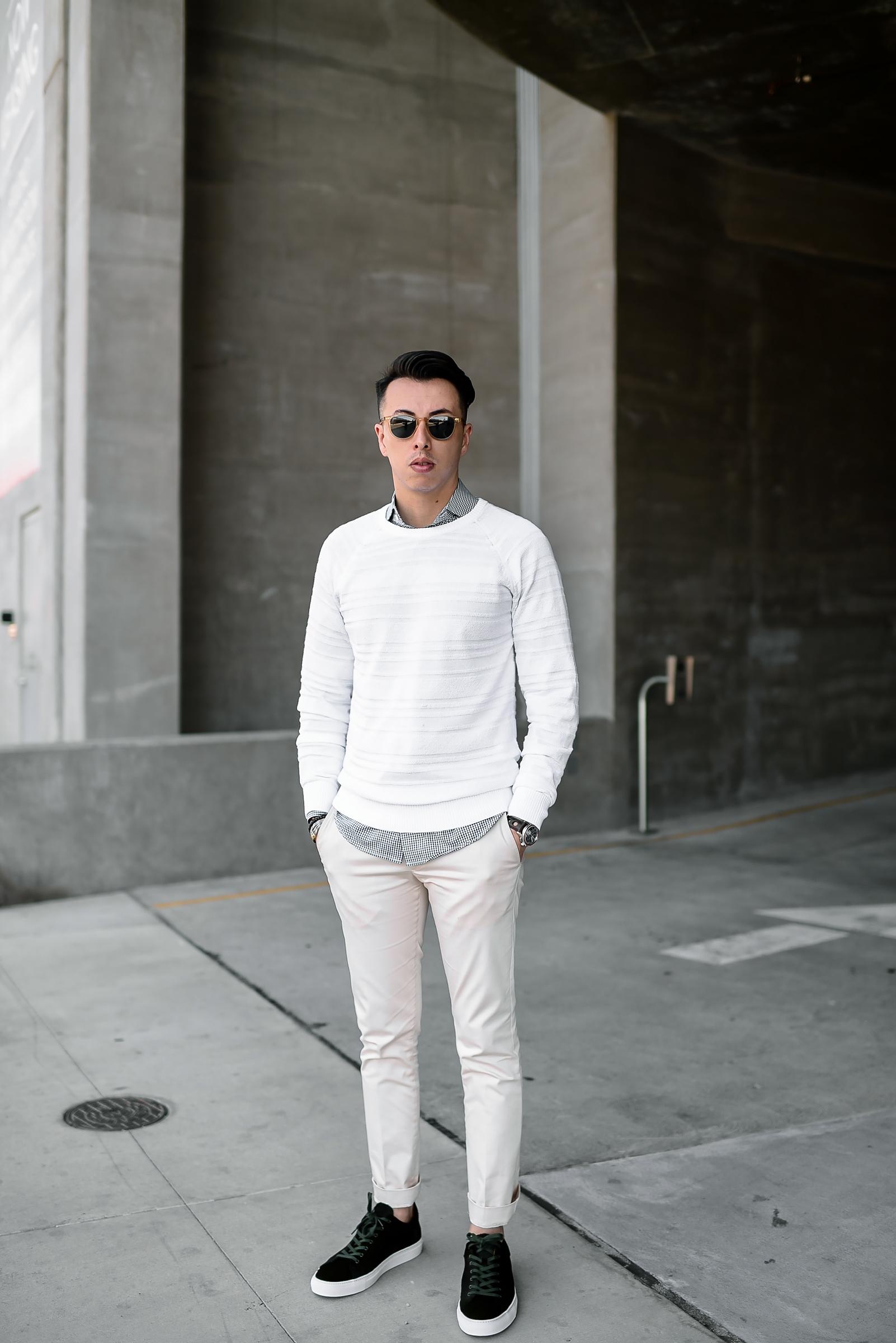 man in white sweater