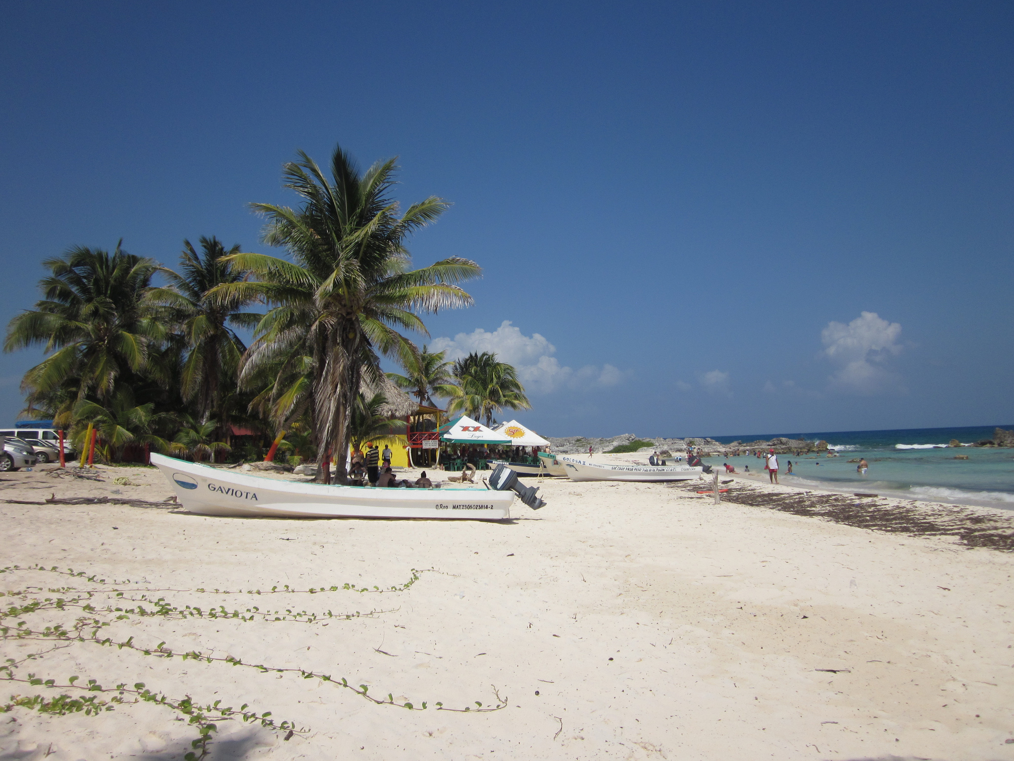 Cozumel beach with boat on shore