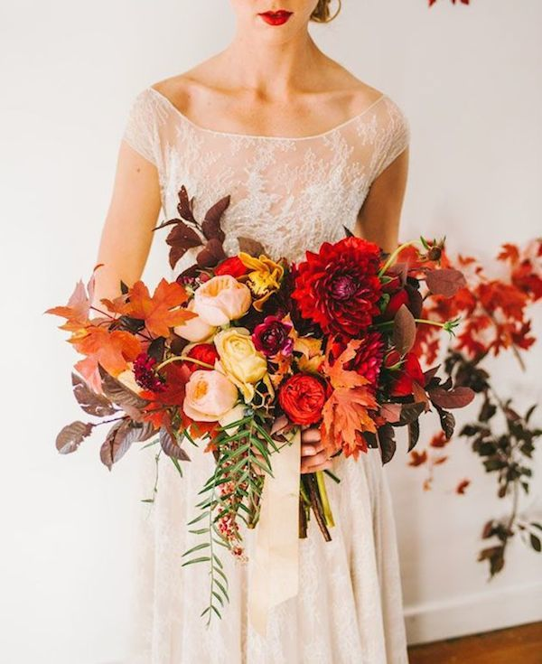 Oranges and reds bouquet flowers