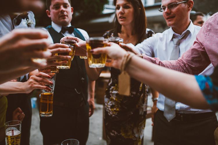 crowd toasts beer