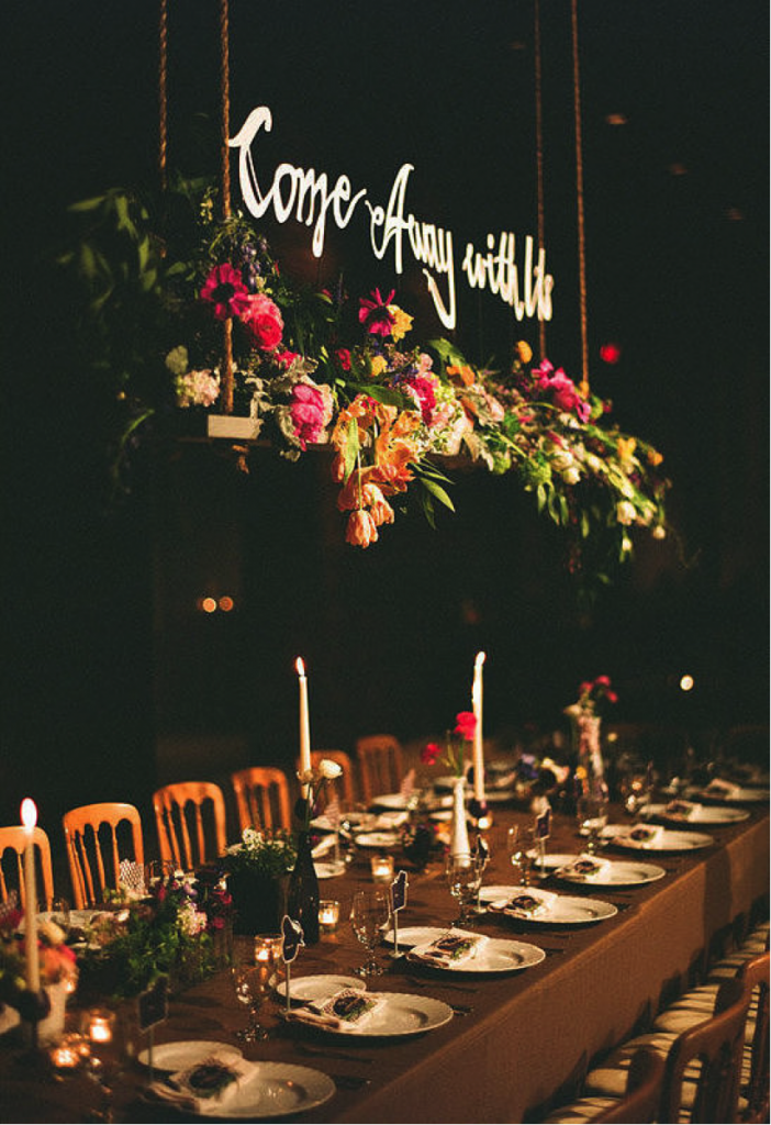 Hanging floral decor with calligraphy sign for rustic wedding table