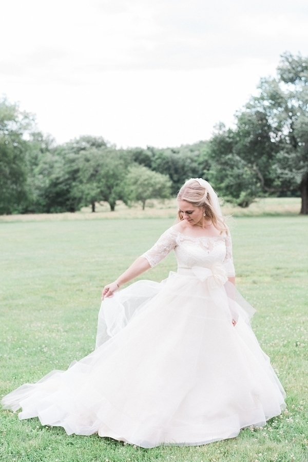Ball gown with long sleeves and bow detailing