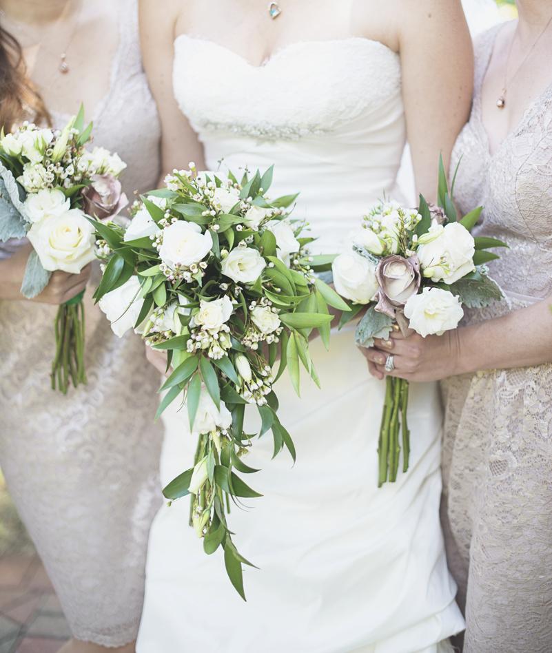 white rose bridal party bouquets