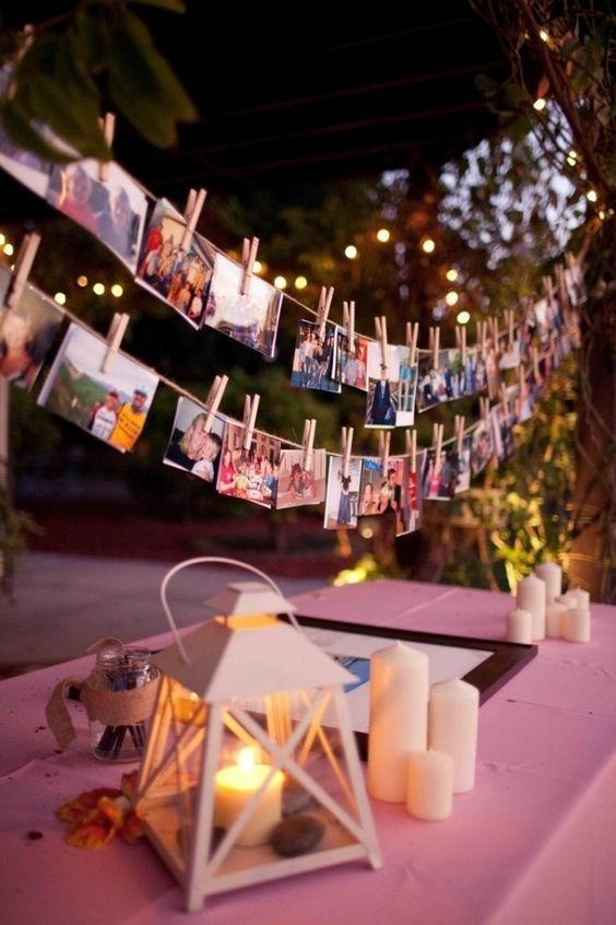 DIY hanging photo decor for wedding table