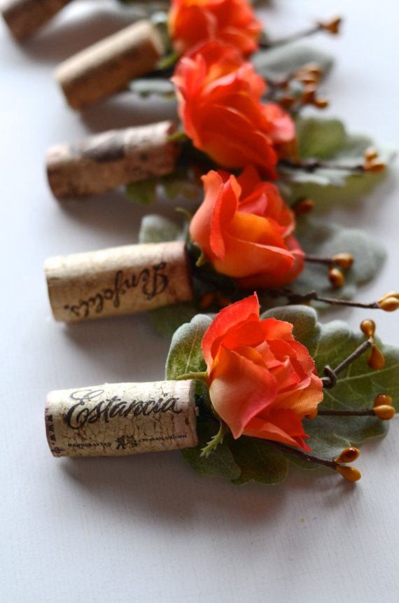 Coral Wine Cork Boutonnieres via Colin Cowie Weddings.