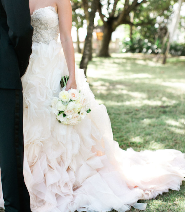 Detailed bodice and layered skirt wedding dress