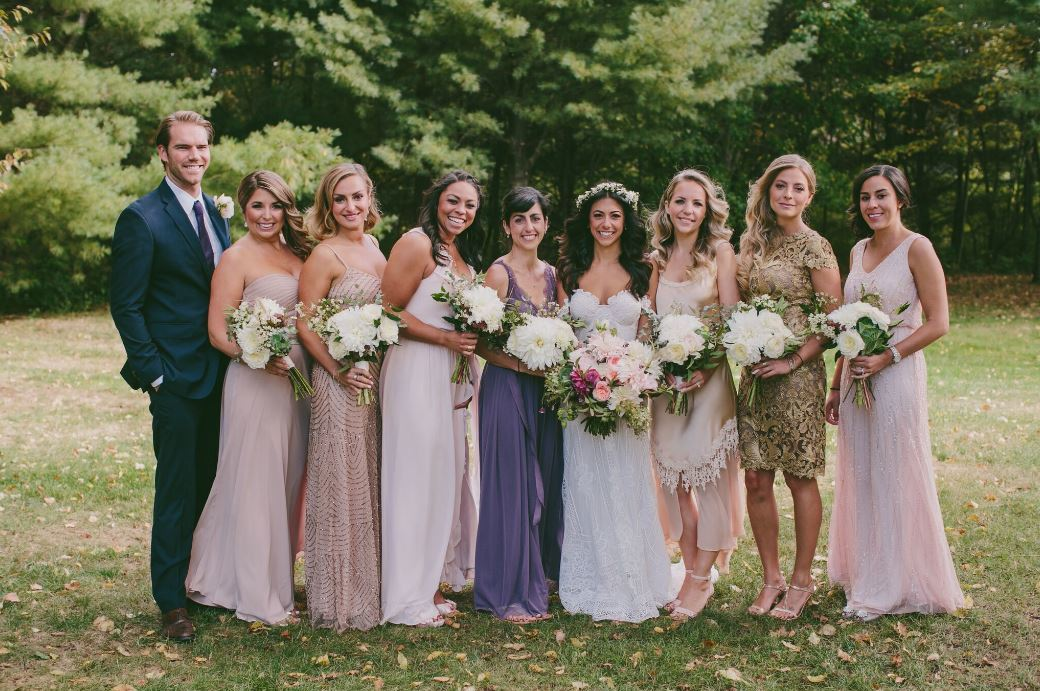 Bridal party wearing mismatched bridesmaid dresses