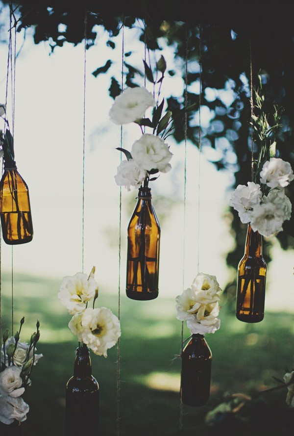 Hanging bottle wedding decor for outdoor wedding