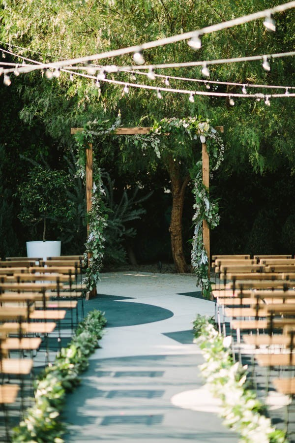 greenery wrapped arch