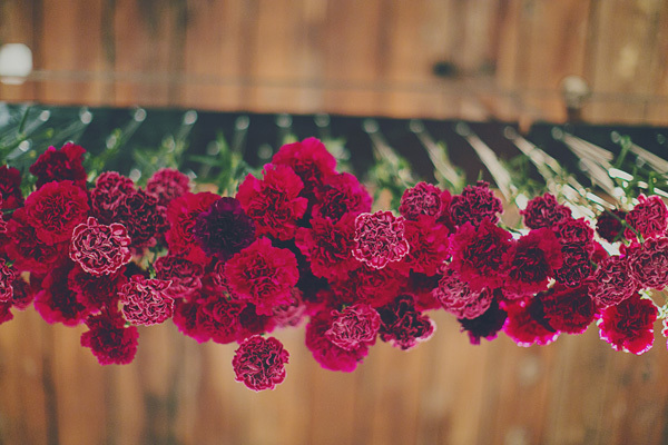 Hanging jewel toned floral decor for vintage wedding