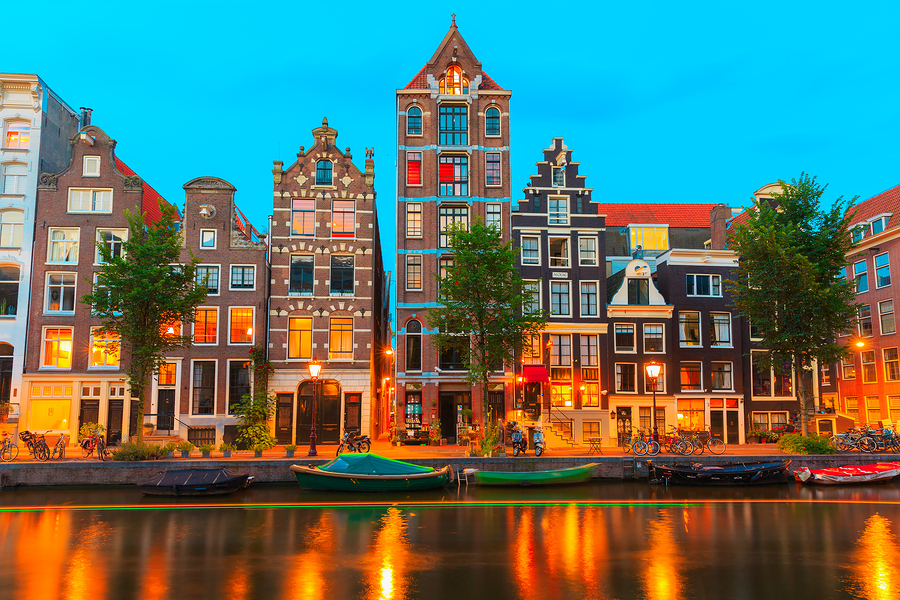 View of Amsterdam city with lights reflected on water