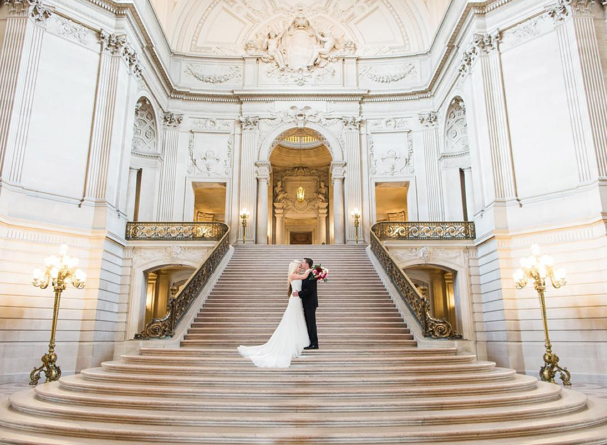 City hall wedding photo in front of stairs