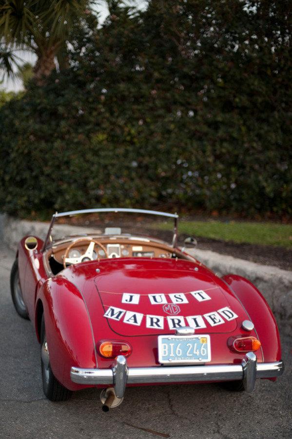 red convertible wedding car
