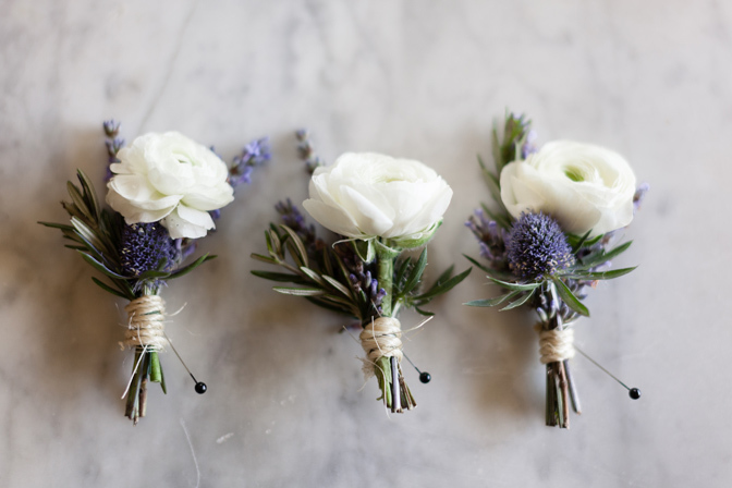 ranunculus and thistle boutonnieres
