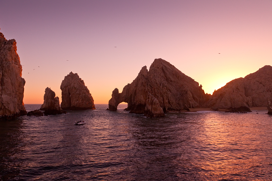 Cabo San Lucas rocks in water at sunset