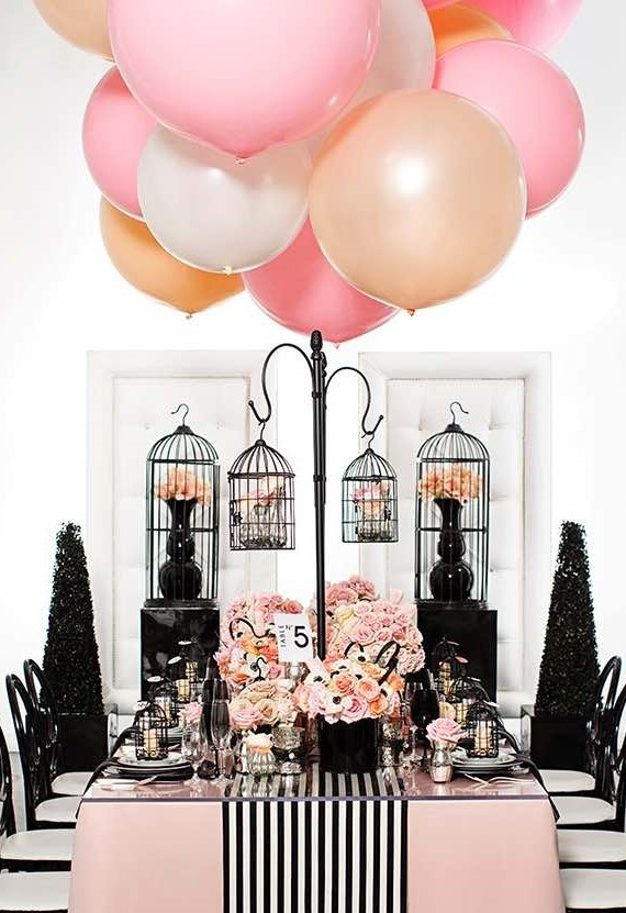 Pink balloon decor with black hanging lantern centerpieces for modern chic wedding