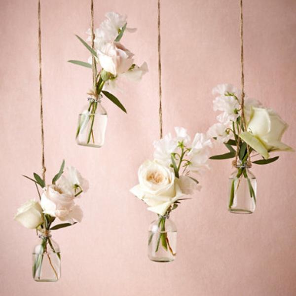 white roses in bud vases