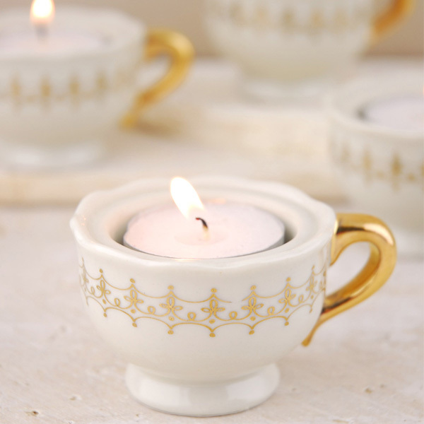 candle in tea cup