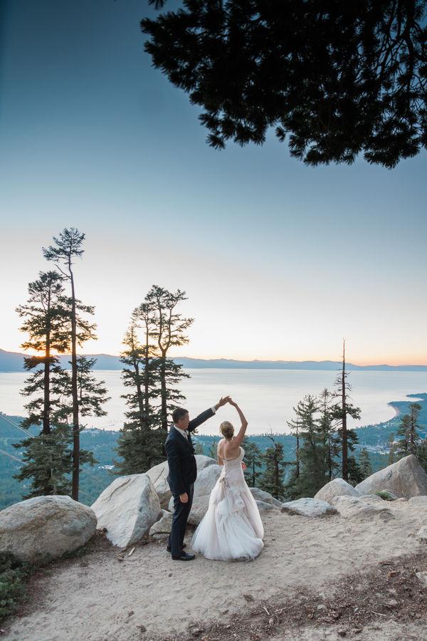 Wedding couple dancing outside on mountaintop
