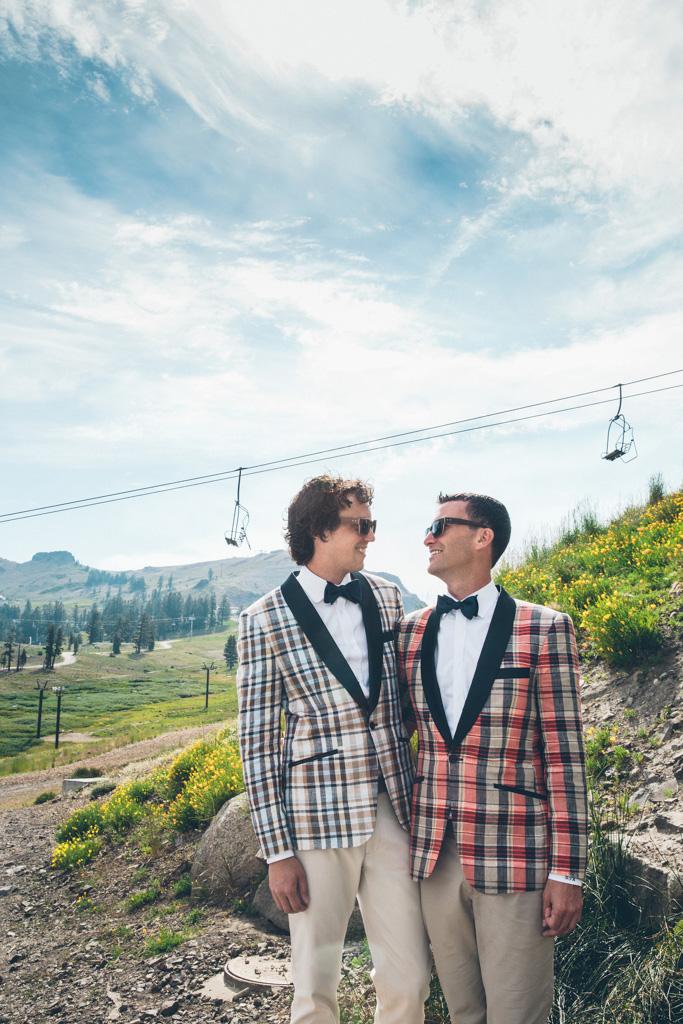 a male wedding couple outdoors near a ski lift