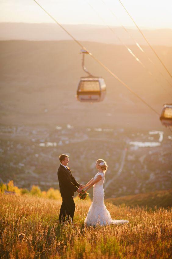 Outdoor groom and bride below a ski lift
